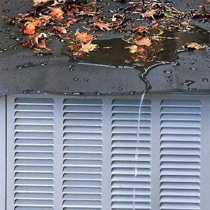 Covered Air Conditioner Protected from Fall Leaves and Rain Water