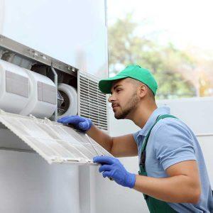 Service Technician Inspects HVAC Equipment