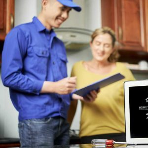 HVAC Technician and Homeowner Discuss Service Options
